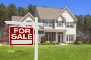 for sale sign in front of chicago area house representing real estate transactions